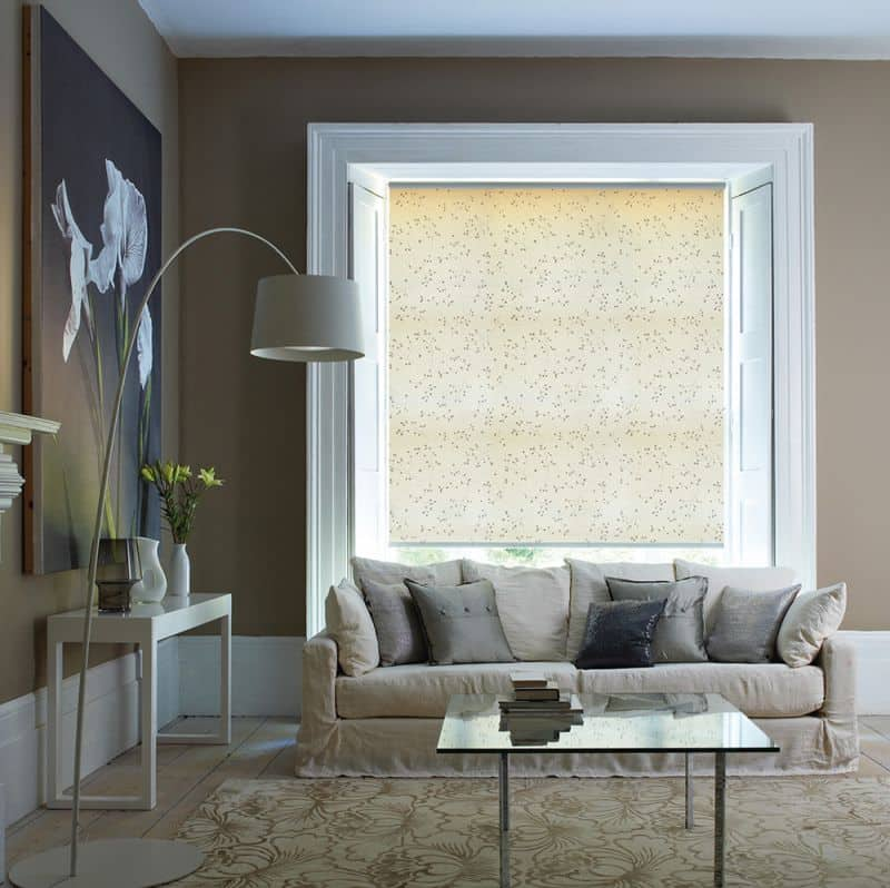 Living room with a patterned fabric roller blind