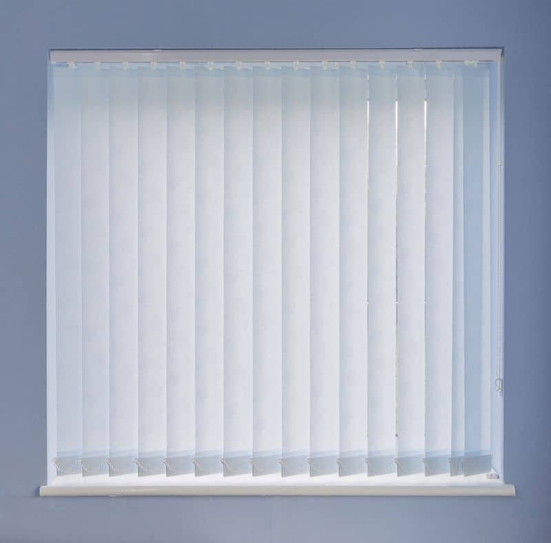 A white vertical blind in a square window