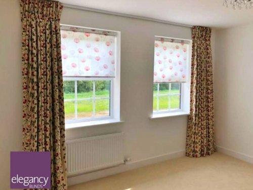 Double pinch curtains on truck and roller blinds
