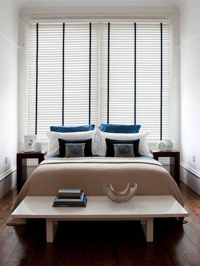 White venetian blinds in a bedroom